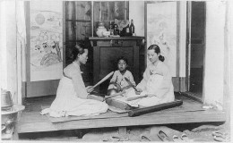 Korean women ironing with wooden sticks circa 1910