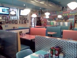 The decor is colorful retro 50s style