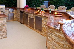 This is a beautiful display of a summer kitchen aside the swimming pool