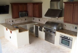 If you have plenty of room, this large outdoor kitchen may be the one for you and your family.  Located inside the screen enclosure, just a few step from the swimming pool, this is excellent outdoor living!
