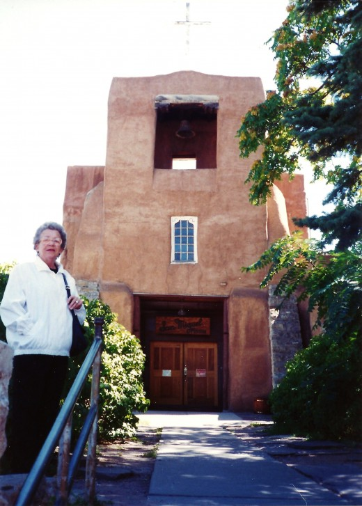 My mother standing outside of the oldest church in Santa Fe, New Mexico.