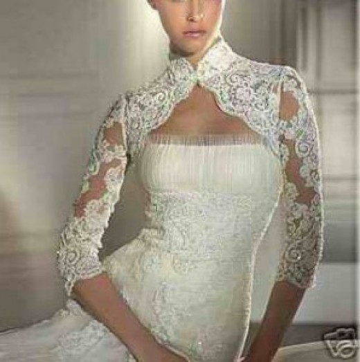 wedding gown with bolero jacket made with lace.