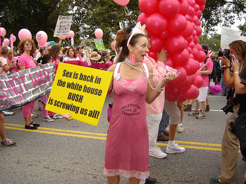 "Lovely Code Pink woman. ""Sex is back in the White House, Bush is Screwing us all."""