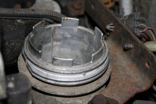 Fuel filter housing with filter removed. Note one of the tabs (front - to the left in this picture) is larger than the rest.