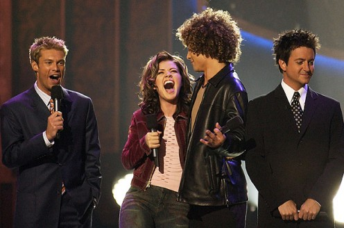 Ryan Seacrest with Season 1 winner Kelly Clarkson, runner-up Justin Guarini, and co-host Brian Dunkleman