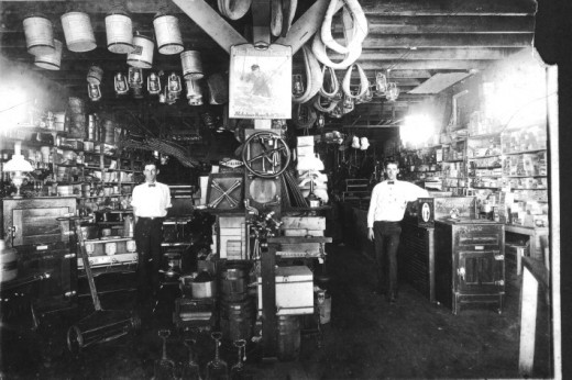 Hard to make out, but the interior of Meserve's Okeechobee Hardware store was a rival to Raulerson's Department store; it had carpeting! Pictured left is proprietor EM Meserve and Judge Henry H Hancock on right