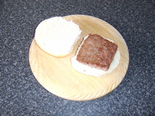 The Lorne sausage is added to the bottom of the halved bread roll