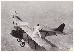 TWO MEN PLAY TENNIS ON AN AIRCRAFT WING HIGH ABOVE THE EARTH
