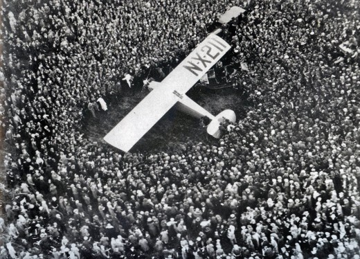 CHARLES LINDBERGH MOBBED BY A CROWD OF 100,000 IN PARIS AFTER FLYING SOLO ACROSS THE ATLANTIC OCEAN