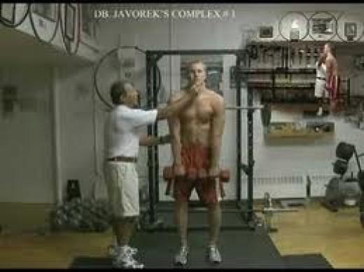 Javorek coaching an athlete through a dumbbell complex