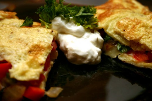 red pepper, onion, parsley, and cheese omelette with sour cream