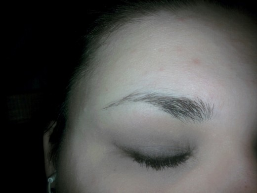 Prime your eyelid and line your eyes with a pencil eyeliner and smudge slightly with a q-tip.  I used Smashbox  Photo Finish Lid Primer  and L.A.Colors eyeliner/brow pencil in black