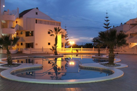 Paloma Beach Apartments pool at night