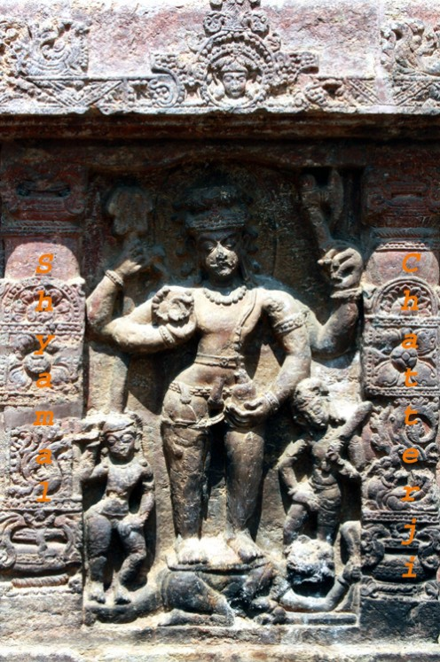 Siva with 'Pasha'- rope,axe,rosary and bowl in his hands.He has fangs, stands on Andhakssura and is ithyphallic. Yogeswari is on his right.