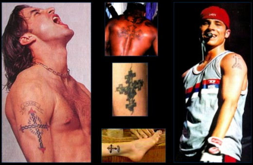 Of course, there are a number of other renditions of the cross tattoo with