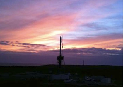 Glory aboard its Taurus launch vehicle, seen, ironically enough, against the sunset.  Photo courtesy NASA.