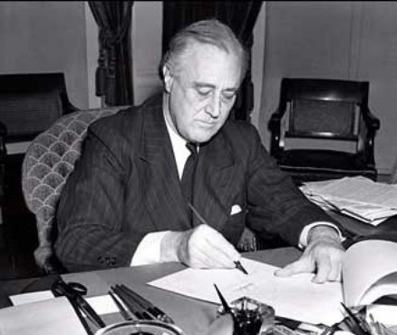 Roosevelt signs the Lend Lease Act into Law.