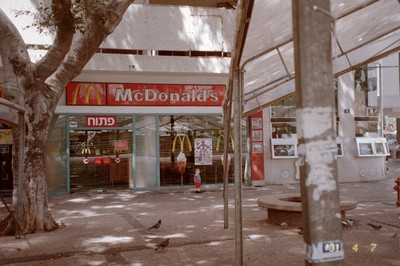 On account of some religious holiday, most of the restaurants were closed. But McDonalds displays an open sign in the window.