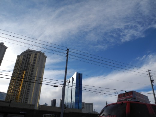 View of the back side of the famous Las Vegas Strip, covered in Chemtrails by 11:00 am, just the time that hundreds of thousands of tourists are ready for arrival-- or checking out from their rooms.  The perfect time for an aerosol attack.