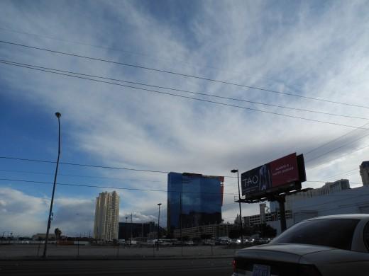 Scenes from Vegas overshadowed by huge Geoengineered clouds that loom over the city.