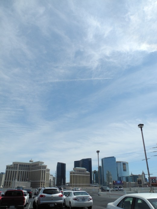 Chemtrail Covered Skies Cover the Entire Strip of Las Vegas, Approximately 12:00 noon -- just at the right time to catch thousands of people as they are walking on the city streets, coming and going from their hotels, etc...