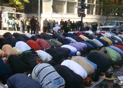 Madison Avenue NY, prayer in the middle of the street.