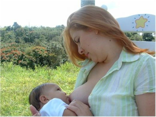 Mom breast feeding baby