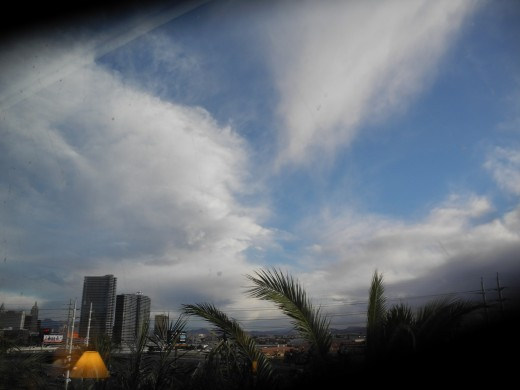 View out window at Rio Hotel.  Strange chemtrail clouds set the backdrop to the scene.  Do the owners of these multi million dollar hotels even look up in the skies?  If so, why are they not having a talk with their Congressmen?