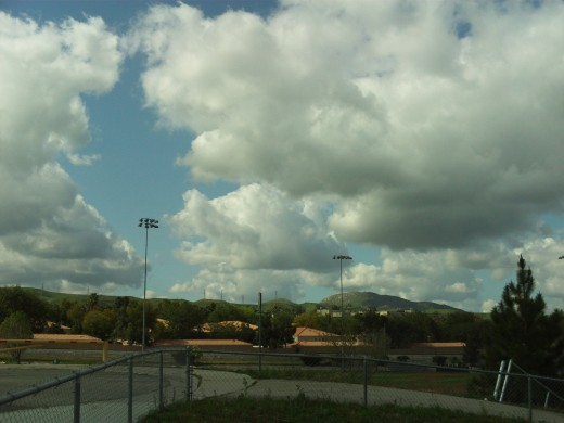 Puffy clouds over a park in Southern California.