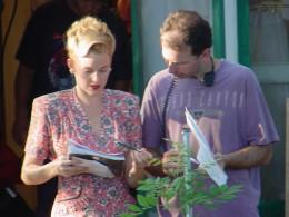 Harriet (Penelope Ann Miller) going over the script.