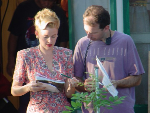 Harriet (Penelope Ann Miller) going over the script.