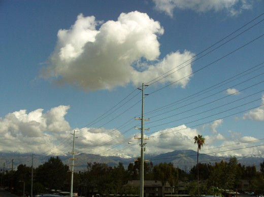 Clouds in the sky with the San Bernardino Mountains in the distance.