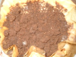 Dry used coffee grounds.