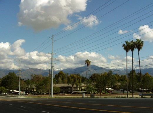 Clouds with a view of the San Gorgonio Mountains in the distance.