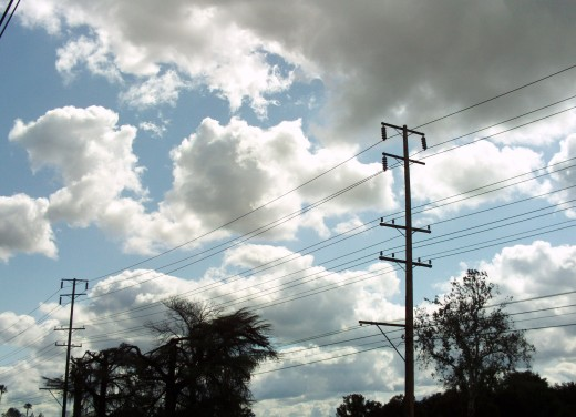 Clouds along with the telephone pole
