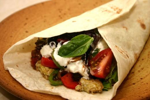 vegetarian breakfast burrito with fried potatoes, eggs, and fresh ...