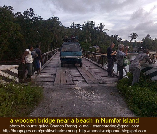 a wooden bridge near the beach of Numfor island