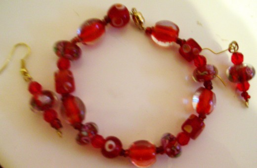 Red beaded bracelet and earring set I made.