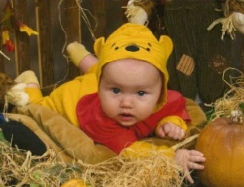 My youngest daughter on her first Halloween in 2007, wearing the same Winnie the Pooh costume that was first worn by her brother in 1994, her sister in 1995, and most recently by my nephew on his first Halloween in 2010.
