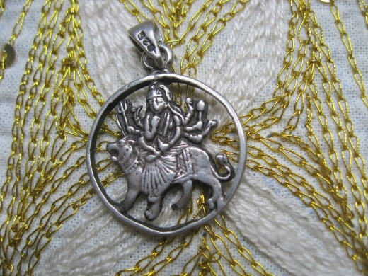Marie-Belle chose this lovely silver medallion of Durga to wear on her hike in the Himalayas.