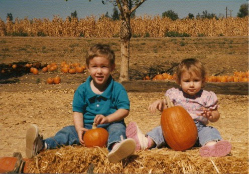 """and so, the great pumpkin rises up out of the pumpkin patch""  My son and daughter on their first trip to pumpkin farm with my dad.  A tradition he kept until they were both teenagers, even when it meant traveling from California to Memphis to do so!"