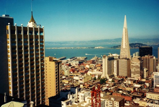 The tall pyramidal shaped building is called the Transamerica Pyramid and is an iconic building in San Francisco.