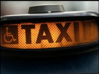 a lit up taxi for hire sign - a welcome sight for many women late at night