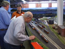 Dennis Weber checks the car numbers on the train he is building in Wausau Yard.