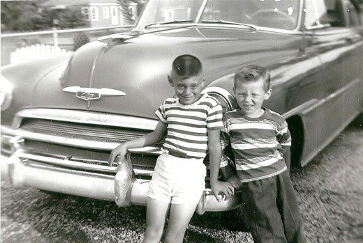 These little boys are too adorable, Joe and little brother John in front of the Edsel?