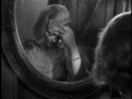 Blanche has trouble confronting herself in the mirror.  Still shot from the 1951 Elia Kazan film starring Vivian Leigh
