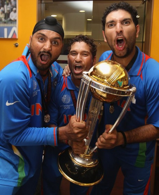 Sachin Tendulkar, Harbhajan Singh and Yuvraj Singh with World Cup 2011 Trophy