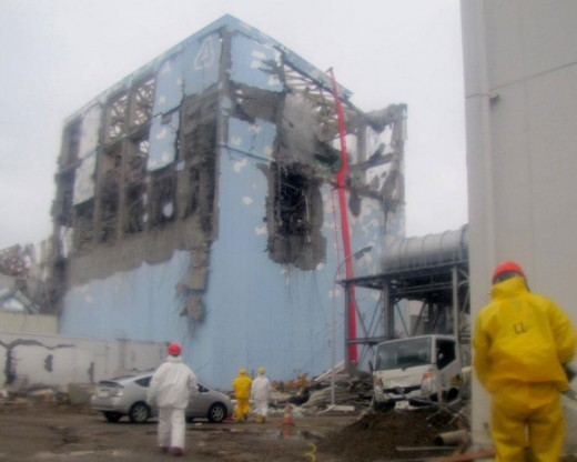 Workers in protective suits conduct cooling operation by spraying water at the damaged No. 4 unit of the Fukushima Dai-ichi nuclear complex on March 2 - this photo released by Tokyo Electric Power Co. (TEPCO) ,