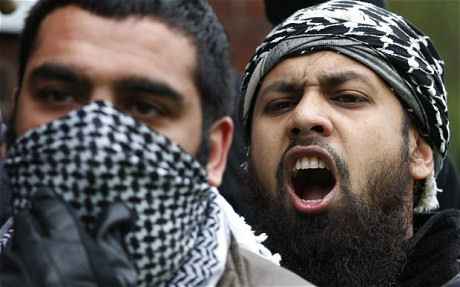 Muslims in their jihad scarves showed up to riot during the Armistice Day rememberance of Britain's war heroes.
