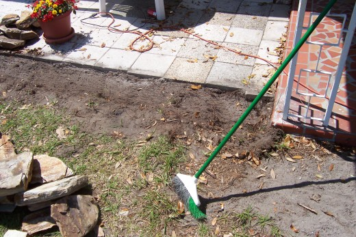 This is where the extension began.  I dug down about four inches then raked it out in preparation for the water.